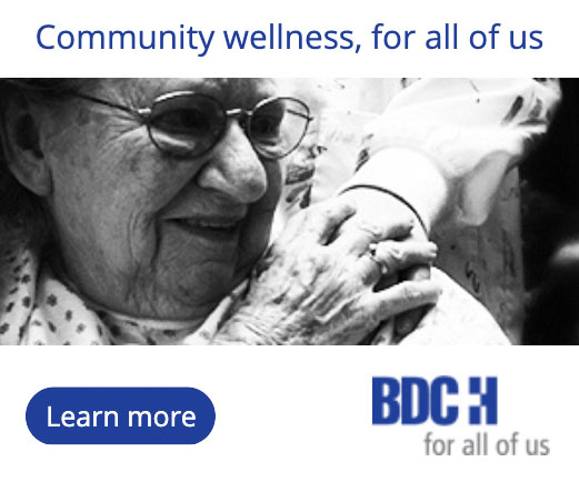 Beaver Dam Community Hospital print ad of elderly woman grasping a hand that has been placed on her shoulder; Community wellness, for all of us