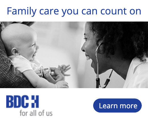Beaver Dam Community Hospital print ad of a nurse looking at a smiling baby; Family care you can count on