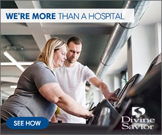 Divine Savior digital ad: trainer helping a woman on a treadmill with the words we're more than a hospital