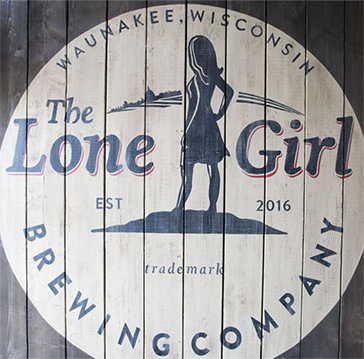 Lone Girl Brewery logo on a wooden wall