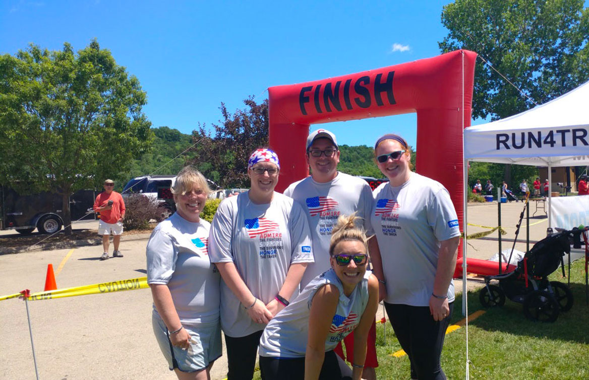 Several TRICOR employees at the finish line of a local 5K race