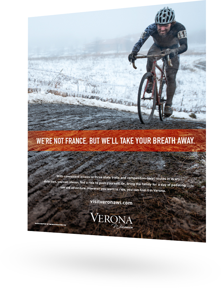 City of Verona ad featuring a bike rider in the winter: We're not France. But we'll take your breath away.