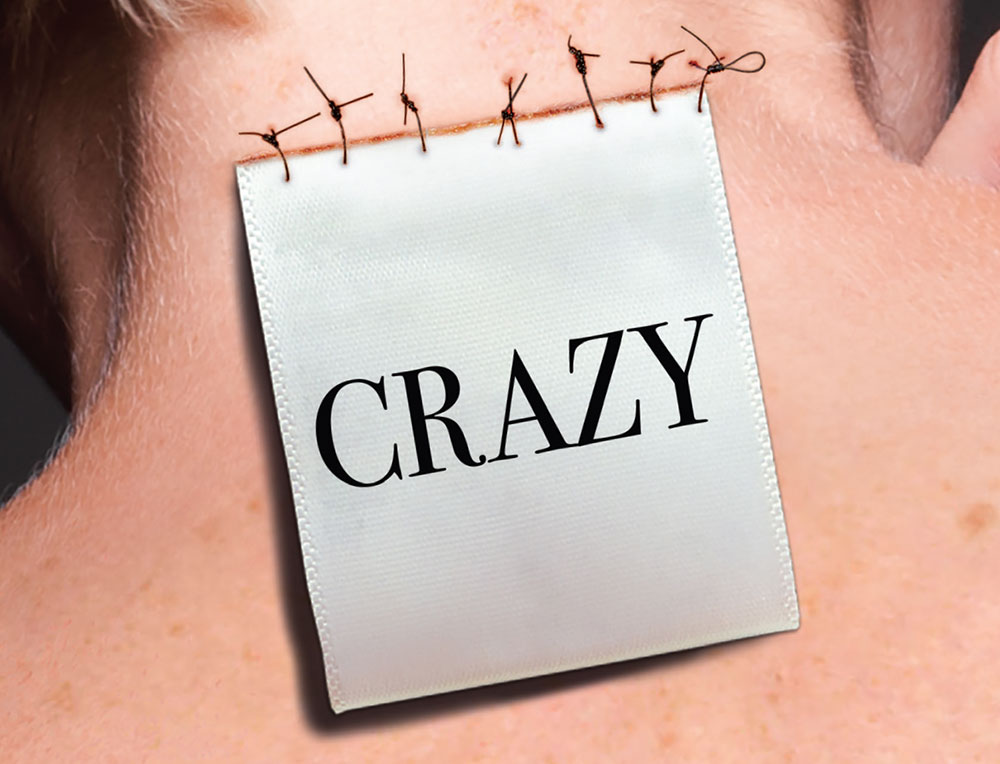 label saying crazy attached to a woman's neck