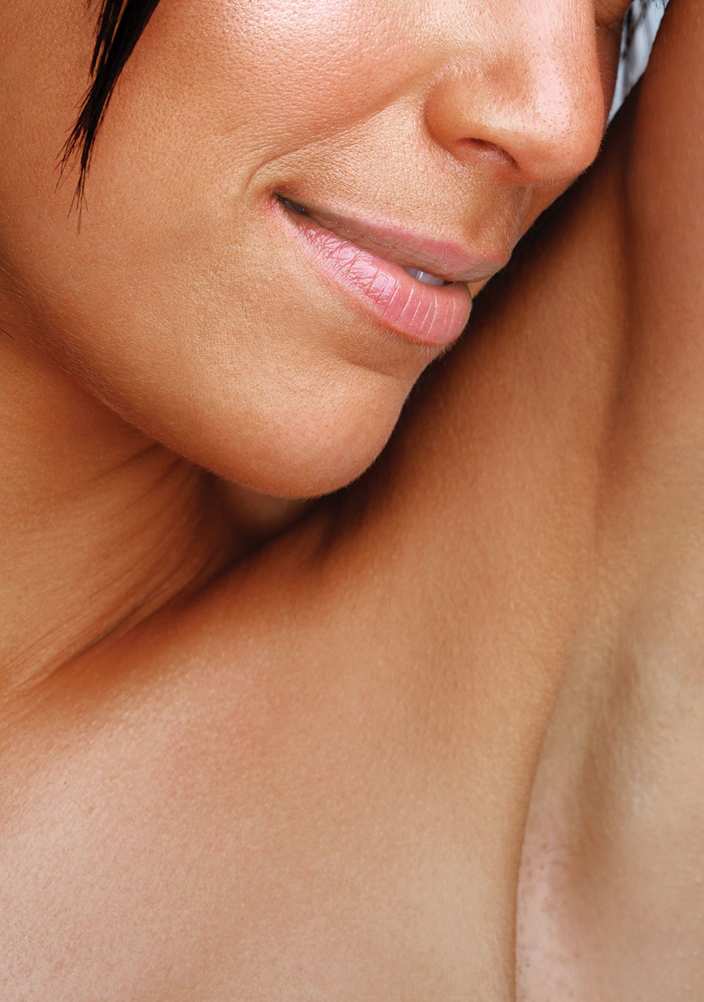 closeup of a woman's armpit, neck, lower face — healthcare marketing print work