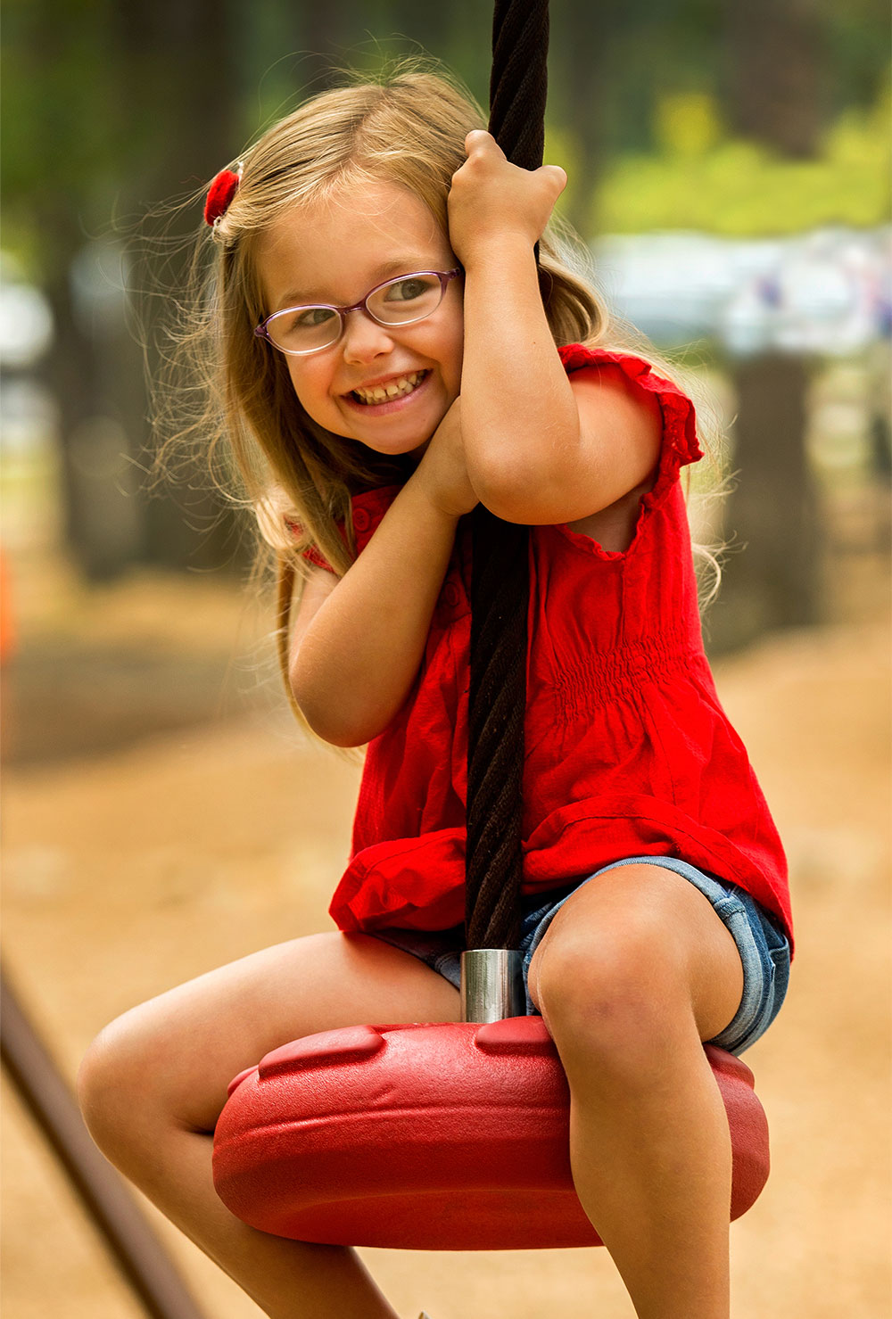 young, smiling girl at a playground